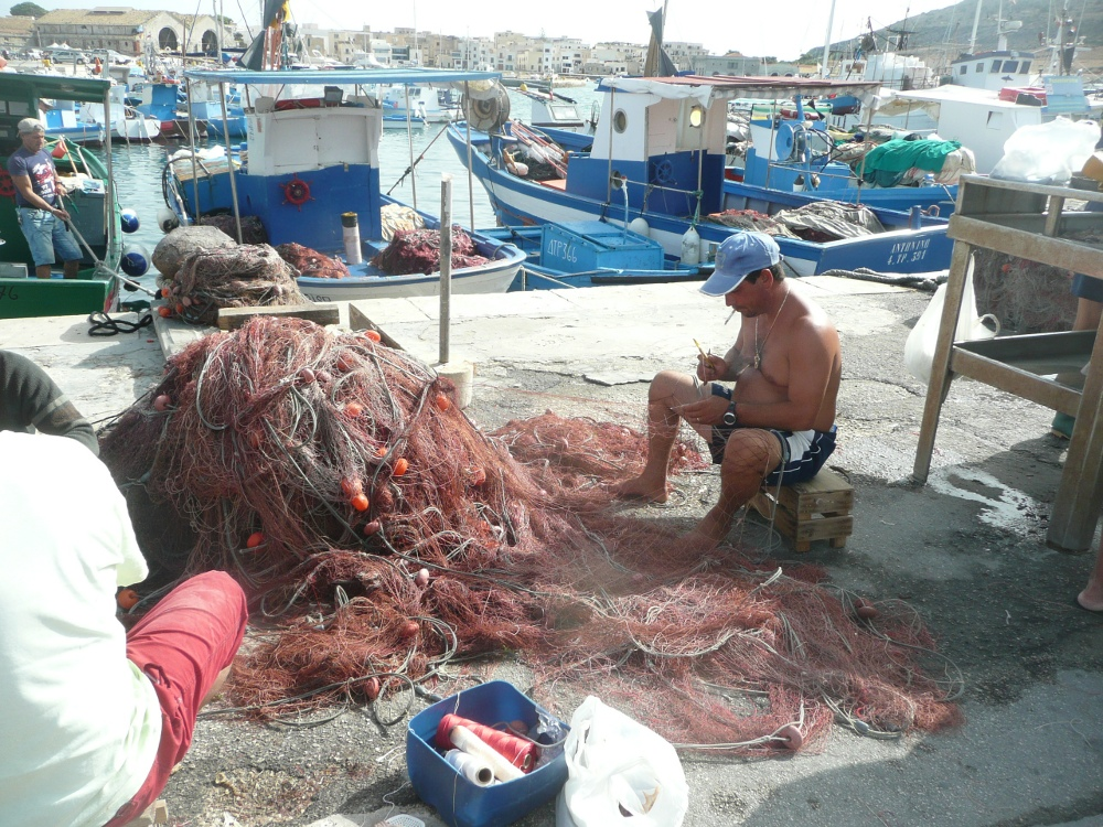 Mending nets in Favignana